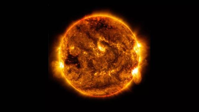 Không phải vàng hay đỏ, đây mới là màu sắc thực sự của Mặt Trời - Ảnh 1.