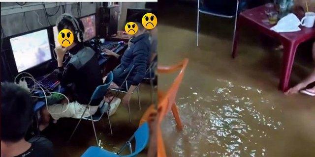 Lũ lụt dâng cao vẫn bình tĩnh quẩy game trong quán net, các thanh niên bị cộng đồng mạng ném đá không thương tiếc - Ảnh 1.