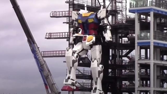 Mời bạn chiêm ngưỡng con Gundam cao 20 mét thực hiện bước đi đầu tiên - Ảnh 1.