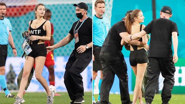"""Nữ CĐV sexy lao xuống sân tại Euro 2020 để quảng bá tiền ảo khiến tất cả có một phen """"mát mắt"""" - Ảnh 3."""