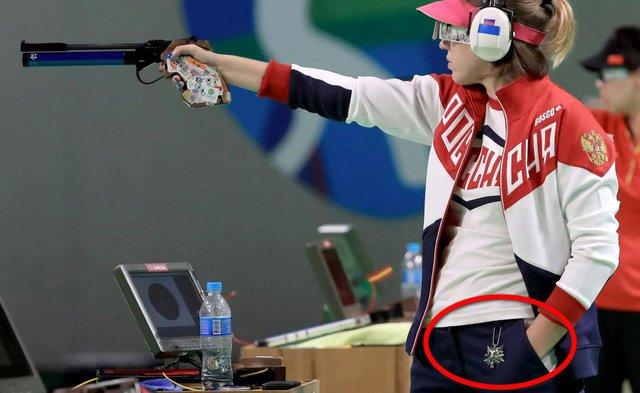 Nữ vận động viên khiến game thủ phát sốt khi đeo vòng The Witcher tại Olympic Tokyo - Ảnh 4.