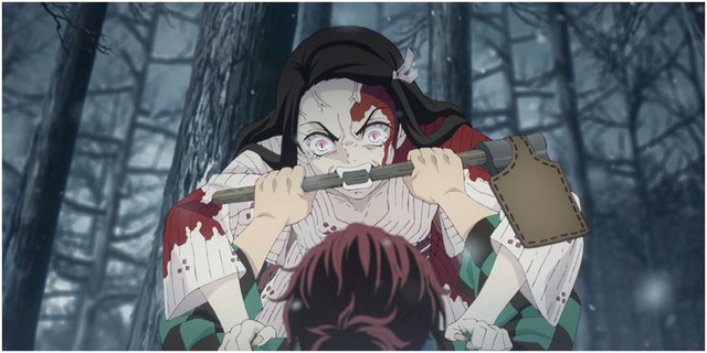 Cán rìu của Tanjiro đã chặn lại khuôn miệng với những chiếc răng nanh khát máu của Nezuko.
