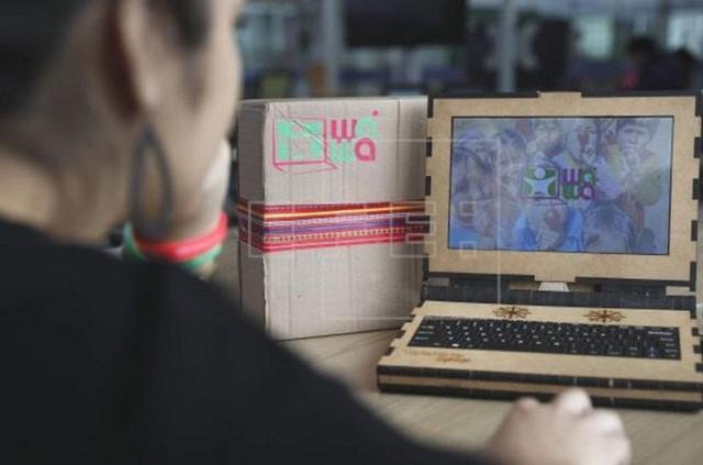Công ty Peru này tạo ra những chiếc laptop bọc gỗ có một không hai, bền bỉ từ khi còn tiểu học đến lúc vào đại học - Ảnh 1.