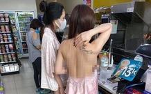 Cô gái mặc áo 2 dây để lộ toàn bộ lưng trần cùng vòng 1 hớ hênh khi mua đồ ở cửa hàng tiện lợi khiến nhiều người