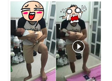 Ông bố trẻ bế con chơi game bằng chân khiến ai cũng phải bật cười
